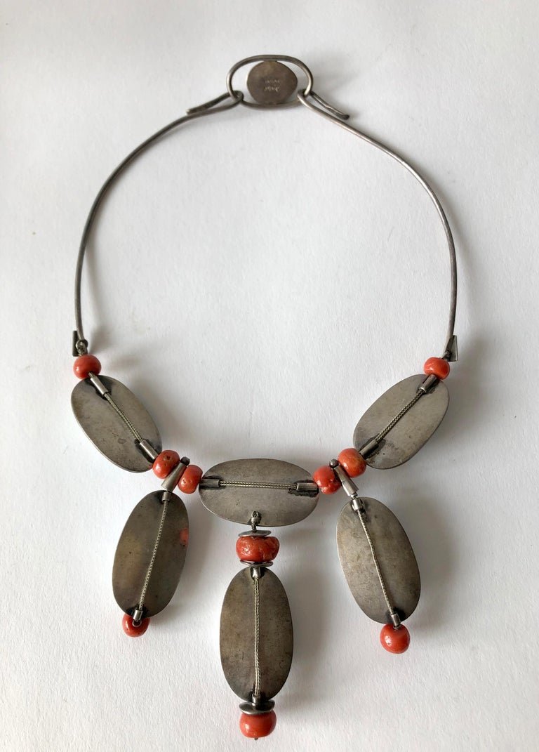 Mother of pearl and coral beaded necklace created by Miye Matsukata for Atelier Janiyé of Boston, Massachusetts. Necklace measures 17.5