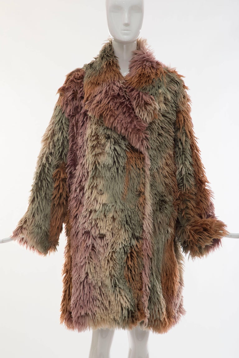 MM6 Maison Margiela's double-breasted coat is crafted of beige, sage, and multicolored faux fur. IT. 40, US. 4  Foldover point collar. Slip side pockets. Double-breasted button-front closure. Lined with white satin. Fabric 1: 84% acrylic, 16%