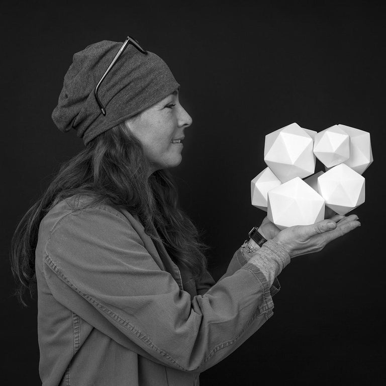 Halfway is a unique medium size contemporary modern abstract geometric wall sculpture by Dutch visual artist Mo Cornelisse. This wall sculpture consists of 15 hand-casted hollow unglazed porcelain elements that are fired together. Each element is a