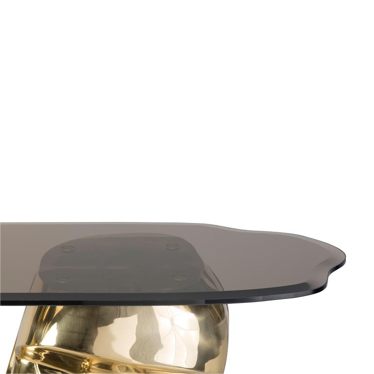 """1. Product description:  The """"Moai"""" console table is made of polished brass cast and its top is a bronze tempered glass piece. This console table inspired by the colossal stone statues located on the Easter Island goes through a process known for"""