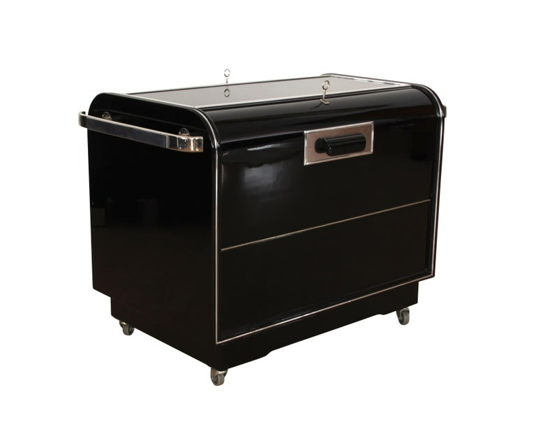 Mobile Art Deco Bar Wagon / Trolley, Black Piano Lacquer, Maple and Chromed parts, France circa 1930  Black lacquered (walnut) wood with chromed parts and blackened glass plate on top. Mobile on four smoothly working wheels. Both upper sides can be