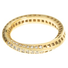 18 Karat Yellow Gold Mobius Band with Squares Holes  Set with 18 Small Diamonds