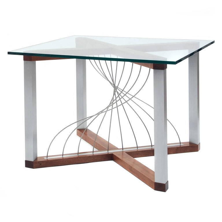 The Mobius end tables are a perfect balance between air and mass. It features stainless steel cables twisted into a beautiful Mobius-like curve. The cables flex to the touch yet naturally return to their position. The frame is constructed with two