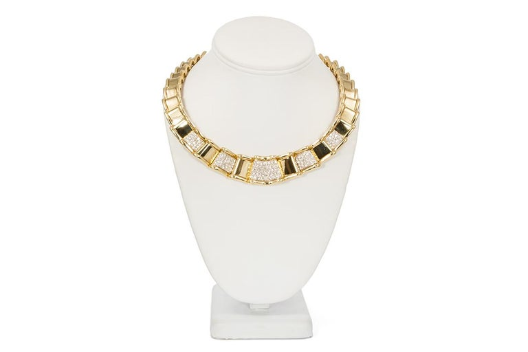 We are pleased to present this Ladies Moboco 18k Yellow Gold & Diamond Ribbon Style Jewelry Set. This unique set features a necklace, earrings and a concealed bracelet style watch all fashioned from 18k yellow and white gold with an estimated