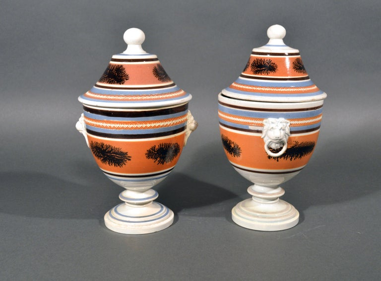 Folk Art Mocha Pottery Covered Urns with Lion-Head Handles, circa 1825 For Sale