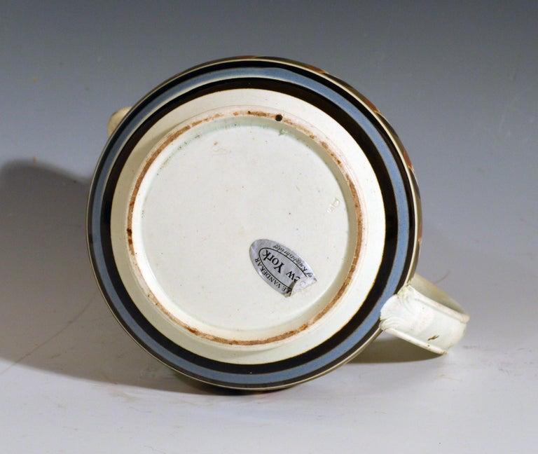 Folk Art Mocha Pottery Double Cat's Eye-Decorated Jug, circa 1820 For Sale