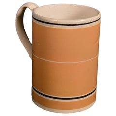 Mocha Pottery Mug with Ochre Slip Ground, circa 1790-1810