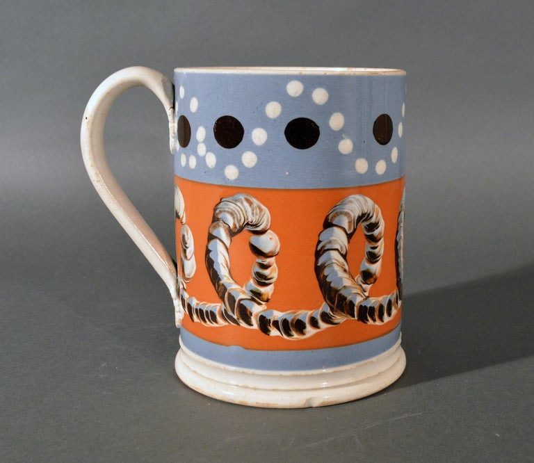 Mocha Tankard with earthworm and dot decoration,