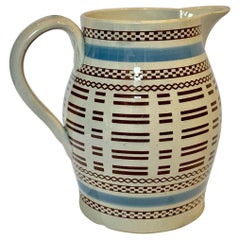 Mochaware Pitcher with Baby Blue and Black Slip Decoration, England, circa 1815