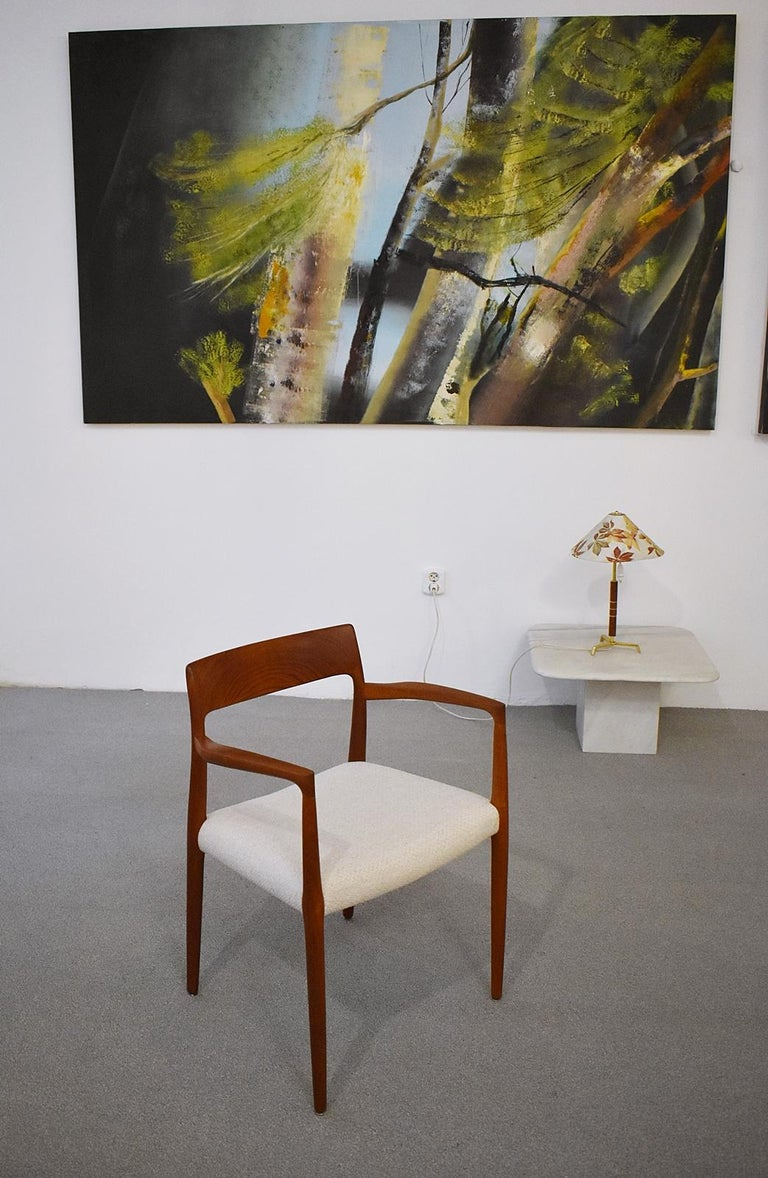 Manufacturer and designer Niels O. Møller, model 57. Teak frame. The chair has been reupholstered and covered with a high-quality fabric in beige. Good restored condition with slight signs of usage.