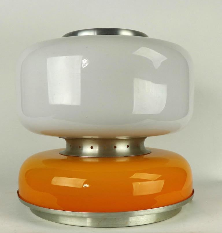 Sophisticated and chic two section glass table lamp attributed to Carlo Nason for Mazzega. The lamp consists of a lower glass section of tan/yellow/orange color, and an upper section of white glass. It has spun aluminum spacer pieces, base top etc.