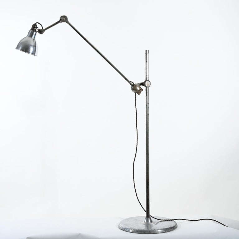 """Rare nickel-plated and aluminium Gras model 215 mobile floor lamp with aluminium """"Normal"""" lampshade produced in 1930.  The Gras lamp became popular when Le Corbusier started to use them first in his offices and then for his customer projects."""