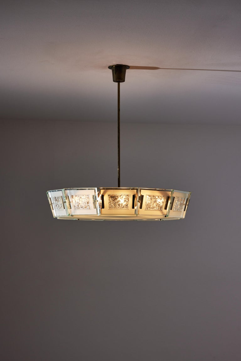 Model 2270 ceiling light by Max Ingrand. Designed and manufactured in Italy, circa 1950s. Satin finish crystal glass diffuser with satin finish crystal chiseled panels. Brass stem and custom brass ceiling plate. Rewired for U.S. standards. We