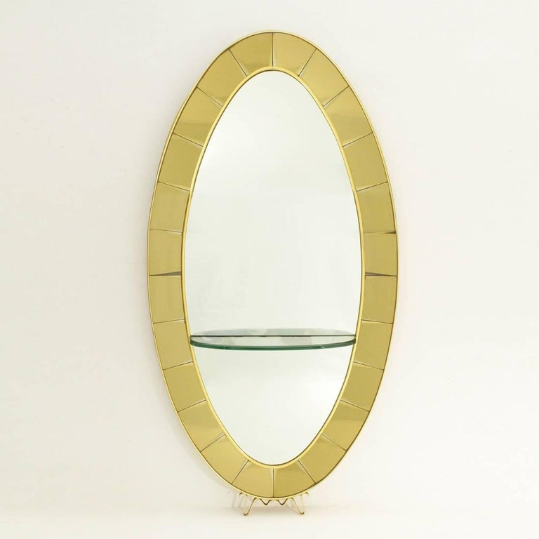 Mirror with shelf produced in the 1950s by Cristal Art.