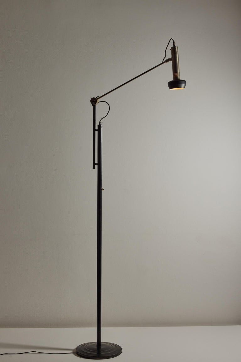 Model 397 floor lamp by Tito Agnoli for Oluce. Designed and manufactured in Italy, 1954. Brushed nickel, steel, painted metal. Original cord, US adaptor included. Adjustable height, arm and shade adjust to various positions. We recommend one E27