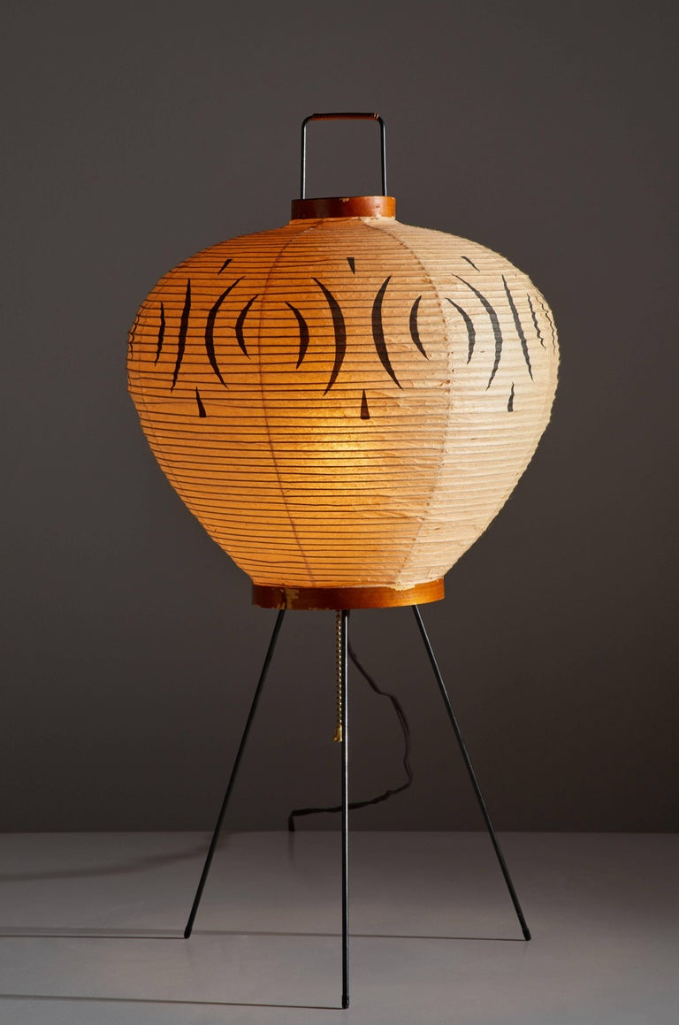 Rare, original model 3A table lamp by Isamu Noguchi for Akari. Designed in Japan, early 1950s. Rice paper, wood and metal handle and legs. Retains the original sun, moon Noguchi stamp. Comes in the original Akari box. Original hand-painted design to