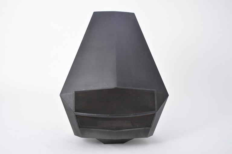 A Model 5005 wall-mounted robust fireplace in black coated steel produced by Belgian company Don-Bar Design in the 1970s. Comes with ash pan, metal suspension handles, grill, fire screen. The clear, sharply edged shape of the hearth makes this