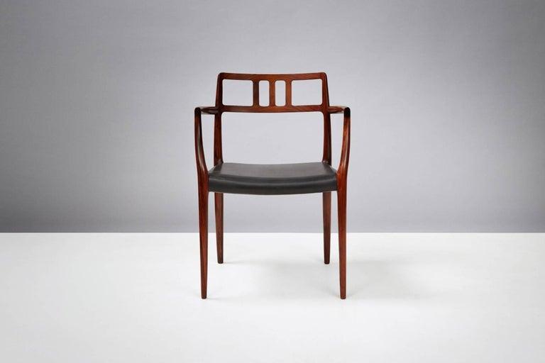 Scandinavian Modern Model 64 Chairs by Niels Moller