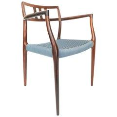 Model 64 Rosewood Armchair by Niels Moller