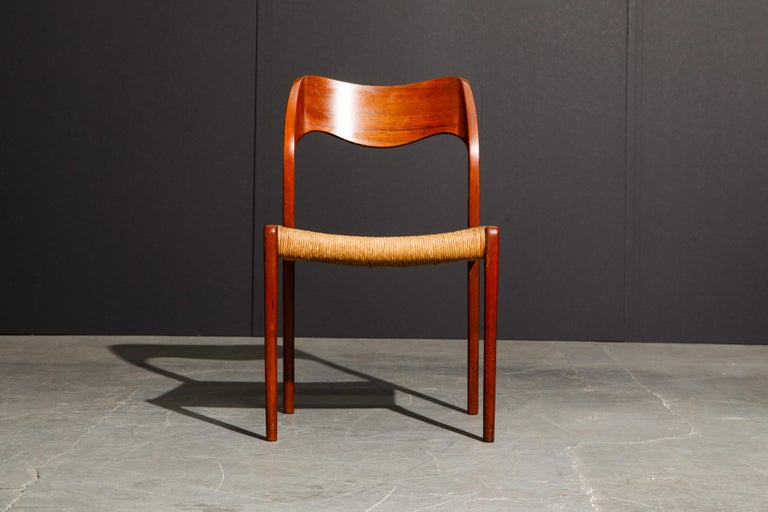 This classic Danish Modern teak side chair is the 'Model 71' designed by Niels O. Møller for J.L. Møllers Møbelfabrik. The teak frame, curved back rest, and original woven cord is striking and stands strong on its own, and also pairs well with other