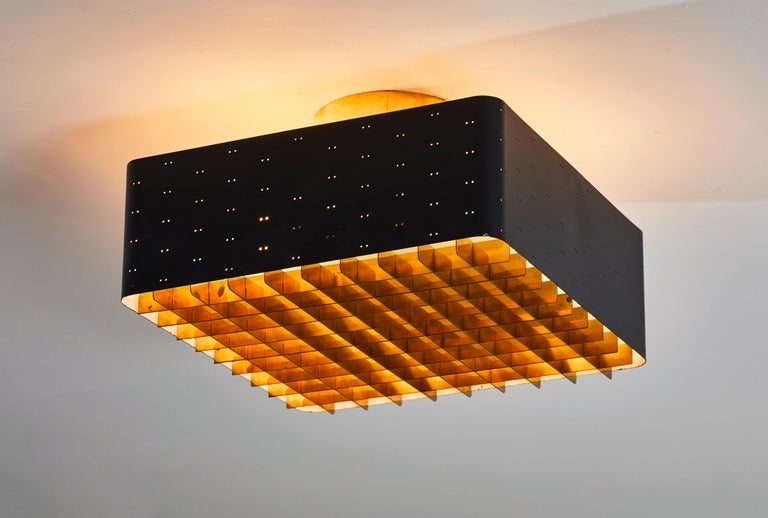 Model 9068 Starry Sky flush mount ceiling light by Paavo Tynell for Taito Oy. Manufactured in Denmark, circa 1950s. Enameled, perforated metal, brass, glass. Rewired for US junction boxes. Takes four E27 40w maximum bulbs.