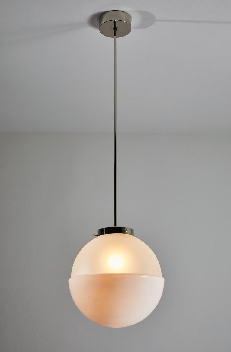 HMB 29/400 pendant by Marianne Brandt. Manufactured in Germany by Tecnolumen. This is a current production that was originally designed in 1928. Nickel plated hardware, opaque and frosted glass diffuser. Rewired for U.S. junction boxes. Takes one E