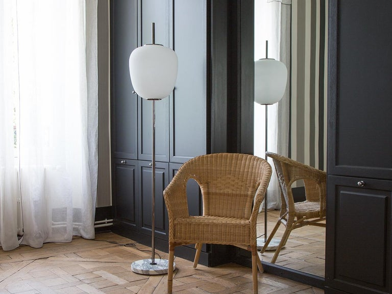 Floor lamp model J14, Joseph-André Motte for Disderot. Today the floor lamp J14 is a re-edition, individually numbered with the associated certificate to guarantee authenticity. The floor lamp, is made from chromed brass, standing on a base of white