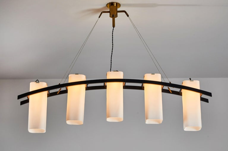Model No. 12701 five shade chandelier by Angelo Lelli for Arredoluce. Designed and manufactured in Italy circa 1950s. Brushed satin glass diffusers, enameled metal armature. Brass hardware and custom brass ceiling plate. Retains original