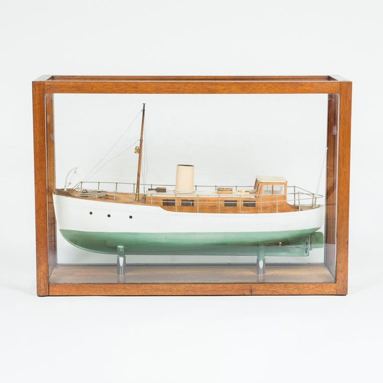 A cased model of a ship, made by F W Murray. 