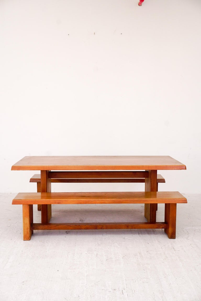 Extremely sturdy example of a vintage elmwood table and benches by Pierre Chapo designed 1960.   Handmade joinery on table and bench ends and metal connectors with patina.   Would be willing to separate benches and table.  Table only: