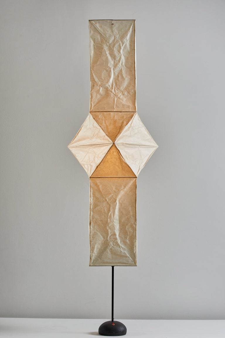 Model UF4-L5 floor lamp by Isamu Noguchi for Akari. Designed and manufactured in Japan circa 1970s. Washi rice paper, bamboo ribbing, enameled metal frame, steel base with signature. Original Sun/Moon stamp. Takes one E27 75w maximum bulb. Bulbs