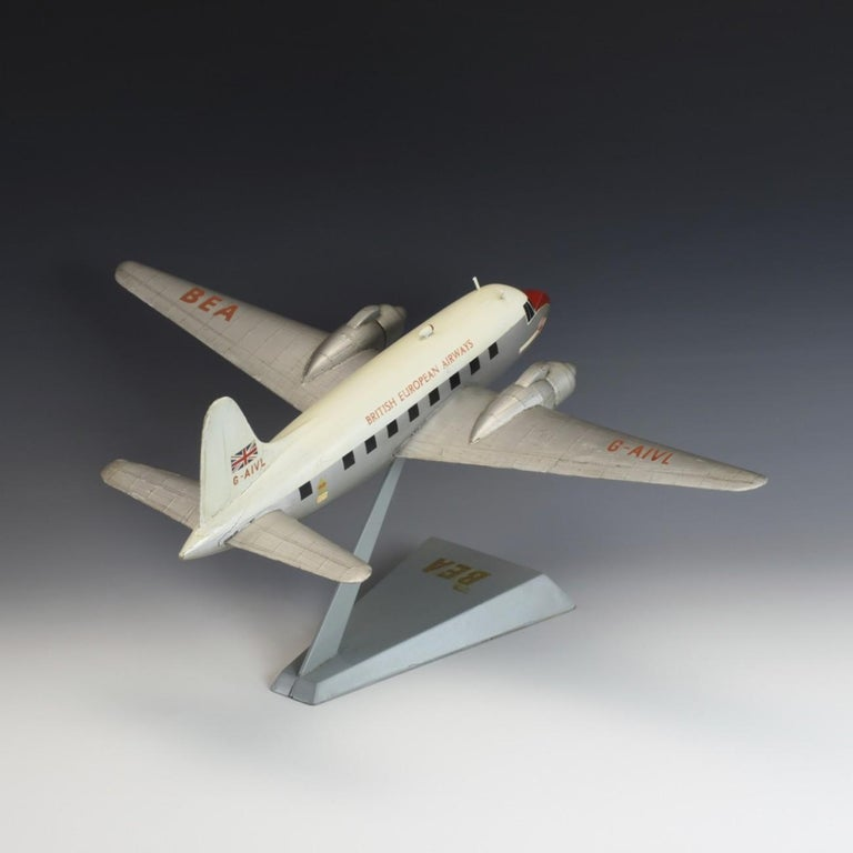 Original hand made wooden model of a Vickers Viking in B.E.A. colours and livery on stand, circa 1950. The Viking that it is modelled on, G-AIVL, has an interesting background and apparently became quite famous having safely survived a serious