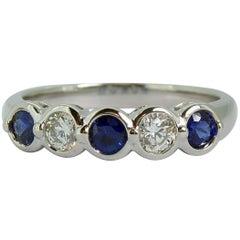 Modern 0.38 Carat Sapphire, 0.21 Carat Diamond Five-Stone Eternity Ring