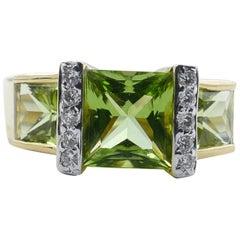 Modern 18 Carat Yellow Gold Peridot and Diamond Dress Ring