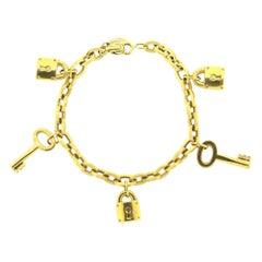 Modern 18 Karat Gold Padlock and Key Charm Bracelet