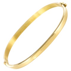 Modern 18 Karat Yellow Gold Thin Bangle Bracelet