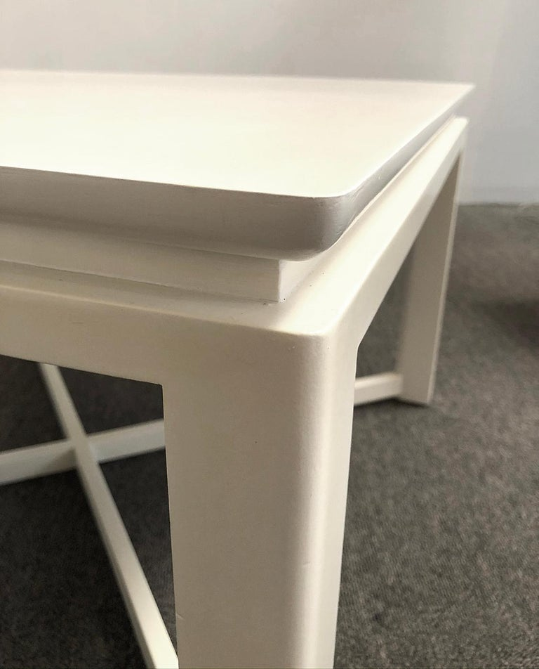 Lacquered modern table from the 1950s. The design is in the simplicity. Excellent craftsmanship. Cream lacquer hand rubbed finish.