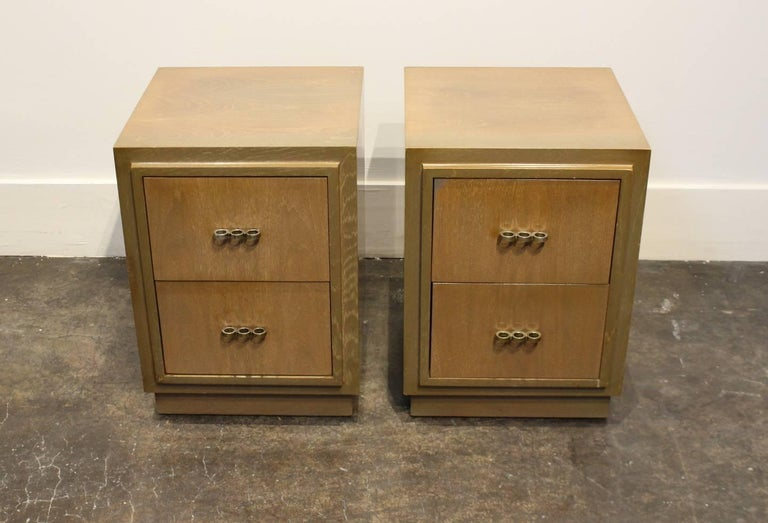 Truly unique pair of 1950s modern nightstands. Striking sharp lines, beautiful walnut wood with olive green tones. Influences of Art Deco, Paul Frankl, and prescient of coming brutalist or minimal trends in furniture. Two drawers per nightstand,