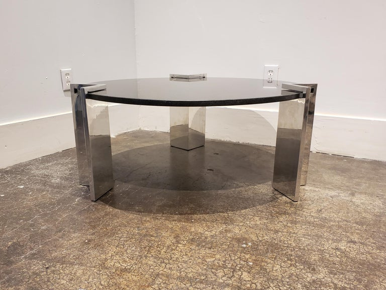 Beautiful modern coffee table with black granite top with white and gold specks. Has three thick, V-shaped, slip-on aluminum legs which come off for easy transport. Top is in great condition with no damage. Legs are in good condition with minor