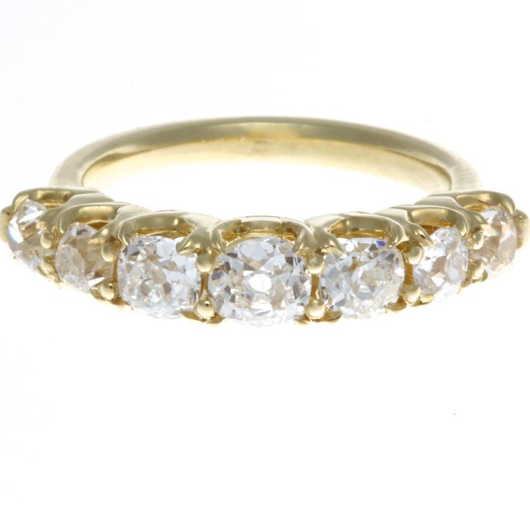 Where Modern meets Victorian. An original creation featuring a striking combination of 18k yellow gold and 7 white diamonds. This ring will be a great addition to your collection and is a timeless piece that can be worn solo any time or stacked with