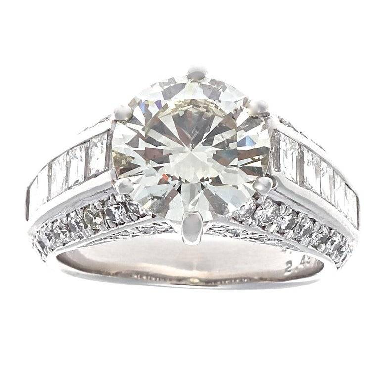 When bigger is better, this ring delivers. Serious finger coverage here, with one large round brilliant  4.06 carat M-N color, SI1 clarity diamond,  and a wide band full of sparkle, including 66 accenting diamonds weighing 2.43 carats H-I color
