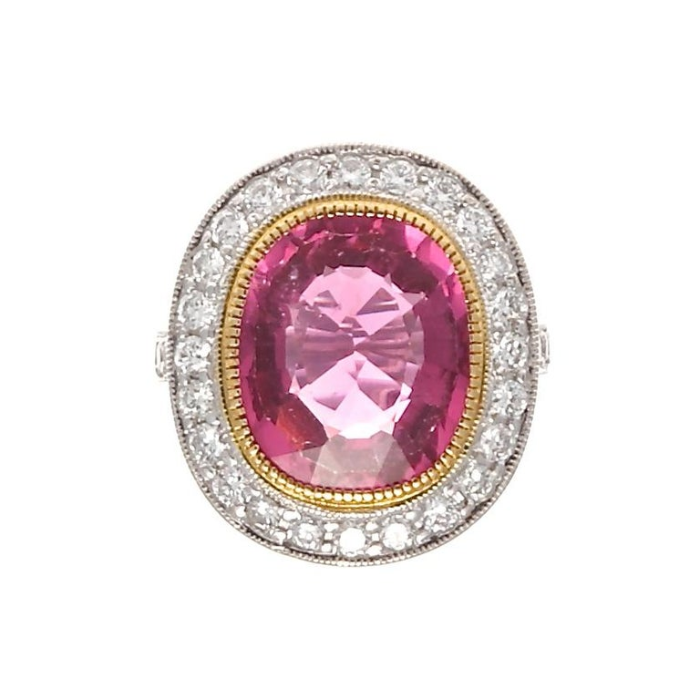 Exuberance is described as the quality of being full of energy, excitement, and cheerfulness. This is perfectly captured through this colorful artistic creation. Featuring a 6.29 carat vivid pinkish-red rubelite tourmaline that is tastefully