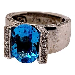 Modern 6.37 Carat Gold Natural Oval Blue Topaz & Diamond Cocktail Gemstone Ring