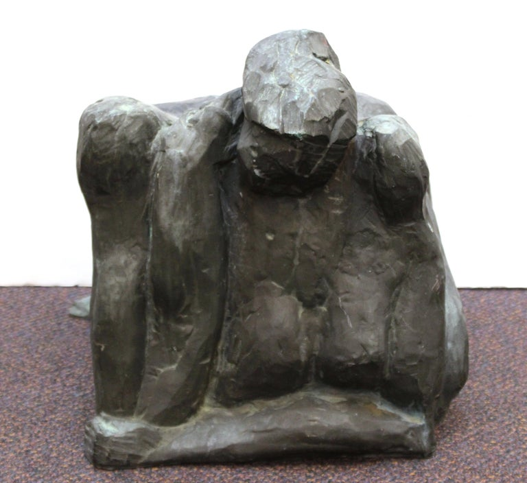 Modern abstract sculpture cast in bronze, depicting a woman crouching on the ground. The piece was made in the mid- to late 20th century and is in great vintage condition, with age-appropriate patina.