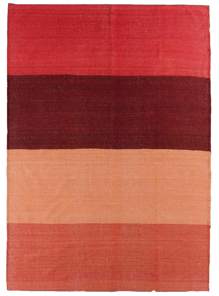 A handwoven wool flat Kilim style rug. Beautiful sherbet tones and in great condition.