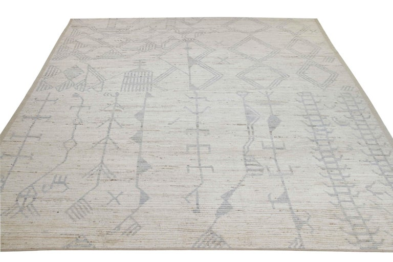 Modern Afghan rug handwoven from the finest sheep's wool and colored with all-natural vegetable dyes that are safe for humans and pets. It's a traditional Afghan weaving featuring a Moroccan inspired design highlighted by a gray mix of tribal