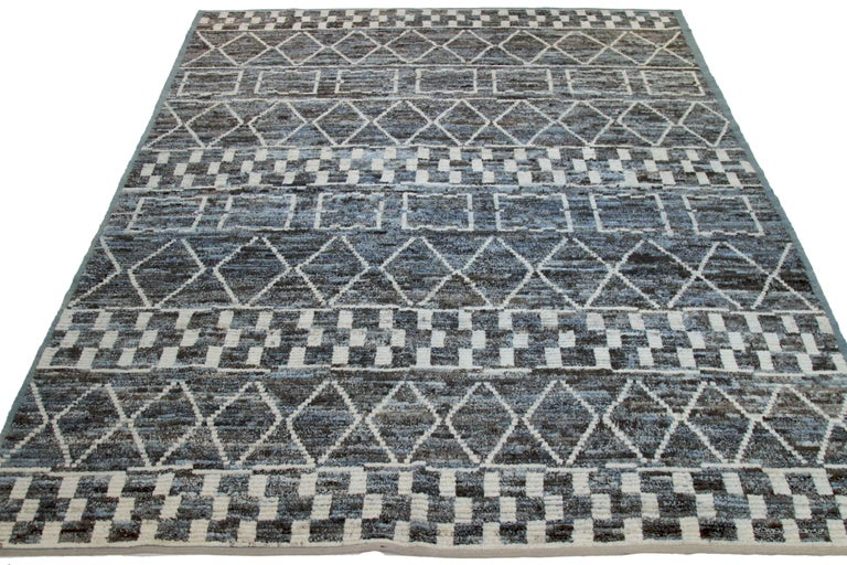 Modern Afghan rug handwoven from the finest sheep's wool. It's colored with all-natural vegetable dyes that are safe for humans and pets. This piece is a traditional Afghan weaving featuring a Moroccan inspired design. It's highlighted by white