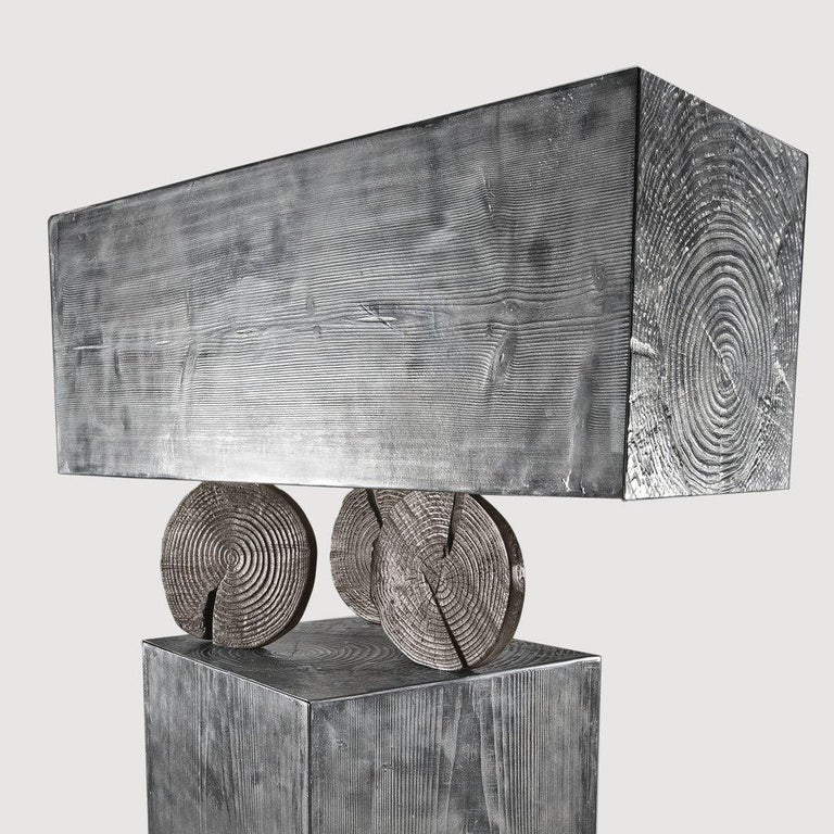 TOTEM cabinet in aluminum cast with wooden-textured container modules suspended by trunk sections for Dilmos Milano. Composed of 2 doored cabinet structures. Signed and numbered by the designer. Suitable for outdoors.  Available also in aluminum