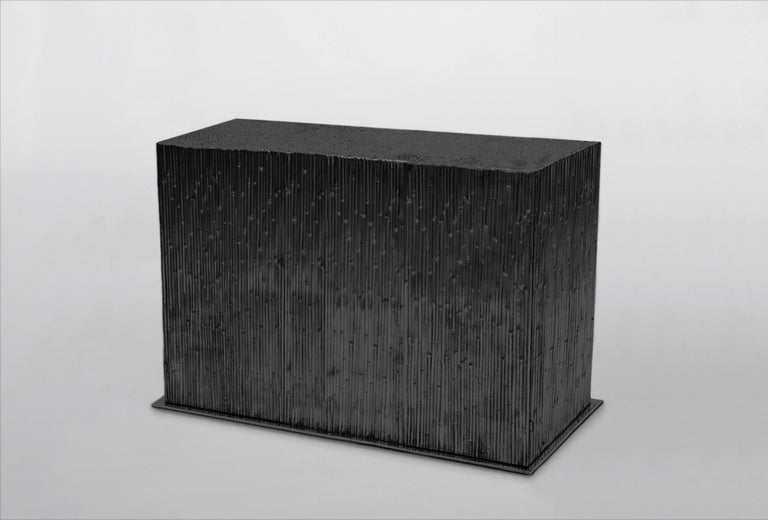 Double door cabinet in black cast aluminium with reed-effect texture on all sides for Dilmos Milano. The interior is embellished with a matte gold enamel lacquer and glass shelves. Signed by the designer.  Size: cm 142 x 46 x 92 H.