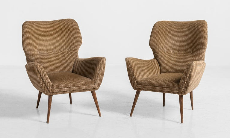 Modern armchairs, Italy, circa 1950  Elegant form with original contrasting two-tone upholstery.